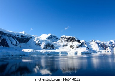 Snow-capped mountains along the coasts of the Antarctic Peninsula, Antarctica