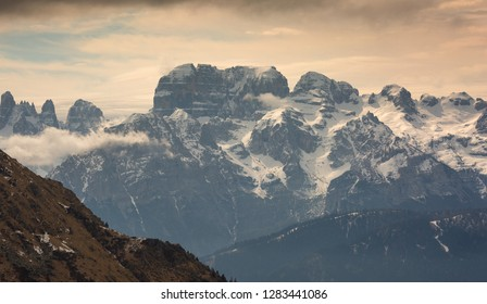 Snow-capped mountains in clouds landscape in alps, Adamello Brenta, Italy