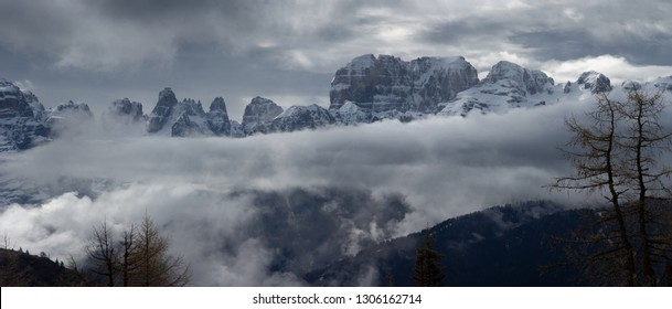 Snow-capped mountains in clouds panorama landscape in alps, Adamello Brenta, Italy