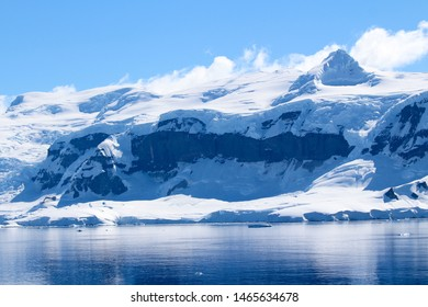 Snow-capped mountains on an island along the coasts of the Antarctic Peninsula, Palmer Archipelago, Antarctica