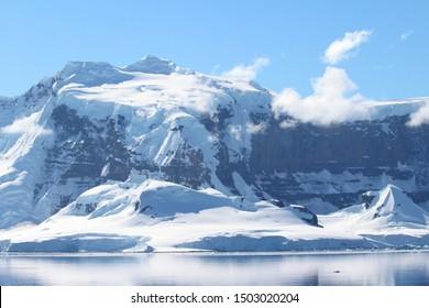 Snow-capped mountains on an island along the coasts of the Antarctic Peninsula, Palmer Archipelago, Antarctica