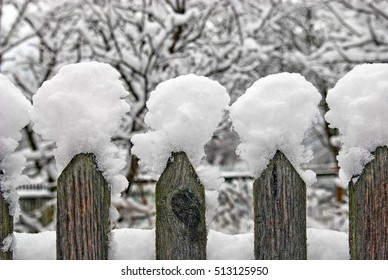 Snow-capped old fence
