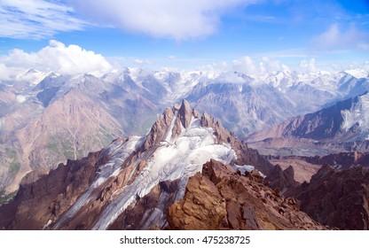 Snow-capped peak.  View of Aristov peak from Nursultan peak at the height of 4200 metres above sea level. Tian Shan, Almaty, Kazakhstan.