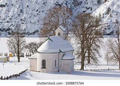 The snow-capped Seehof Chapel on Lake Achen in winter