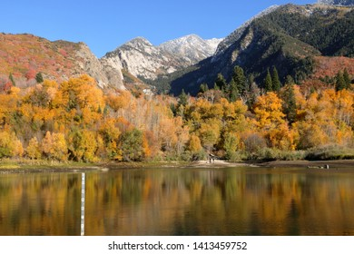 Snowcapped Wasatch Mountains and peak fall foliage at Bells Canyon Reservoir, Sandy, Utah