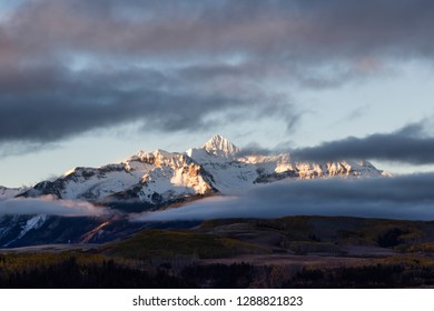 Snowcapped Wilson Peak in Colorado's San Juan Mountains range at sunrise, San Miguel County