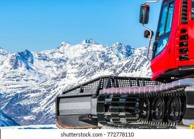 Snowcat, machine for snow removal, preparation ski trails. In the background mountain peaks
