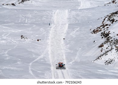 Snowcat rathrak with people, rises to the top of the mountain up. Beautiful landscape of the North Caucasus Mountains at Elbrus