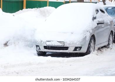 snow-covered car after a heavy snowfall