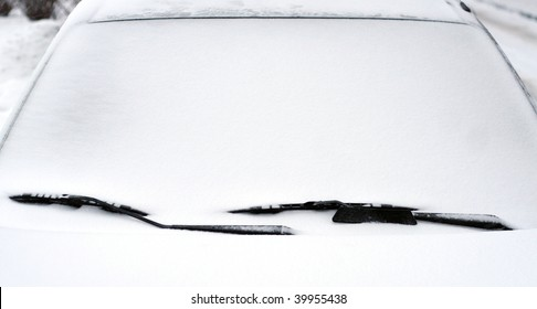 Snow-covered car windshield