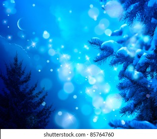 snow-covered Christmas tree on a blue night sky background