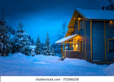 Snow-covered cottage.
