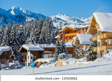 Snow-covered cottages at the Austrian Alps of the Tyrol region.
