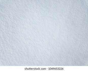 Snow-covered field. Aerial view winter landscape. White texture
