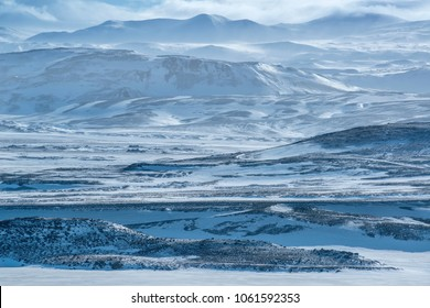 Snow-covered mountains. Central highlands, Iceland.