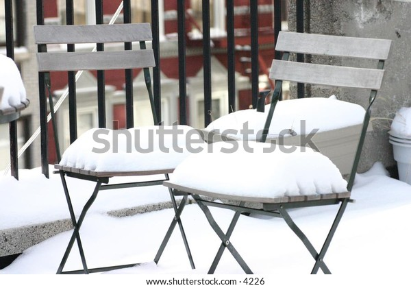 snow-covered patio chairs