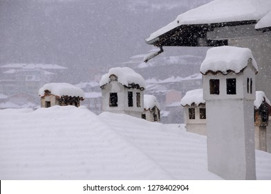Snow-covered roof with chimneys in the town of Veliko Tarnovo in Bulgaria