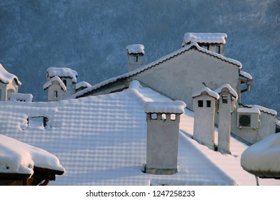 Snow-covered roof with many chimneys in the town of Veliko Tarnovo in Bulgaria