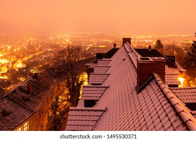 Snow-covered roofs in the town of Wernigerode in the evening