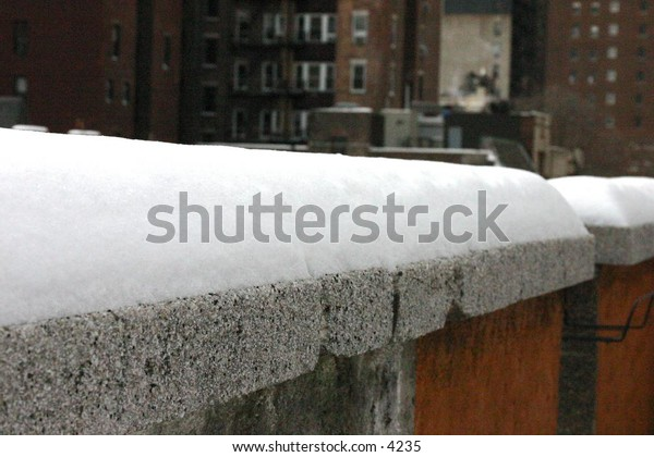 snow-covered rooftop ledge