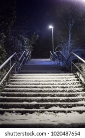 Snow-covered stairs at night