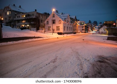 Snow-covered streets and houses, without people, in Tromsø in Norway