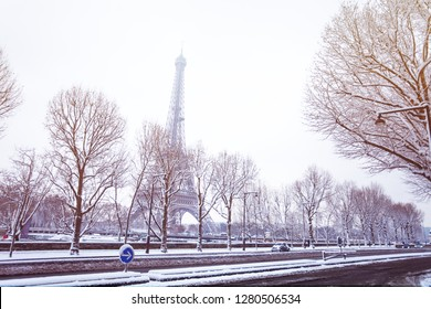 Snow-covered streets of Paris and the Eiffel Tower