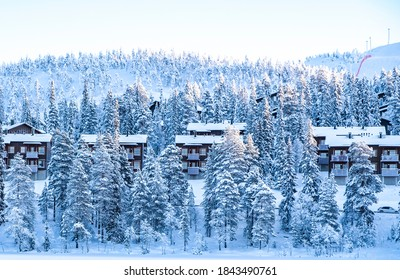 Snow-covered wooden houses and trees in Lapland. Ruka ski slope. - Shutterstock ID 1843490761