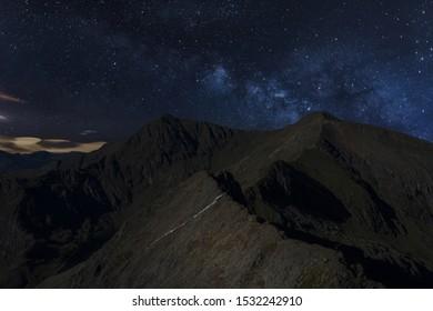 Snowdonia Crib Goch ridge and Mount Snowdon at night, Wales, UK
