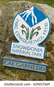 Snowdonia National Park boundary sign. The park was set up in 1951 covers 823 square miles and includes Wales's highest peak Mount Snowdon or Yr Wyddfa. Llyn Celyn Wales UK - April 27 2017