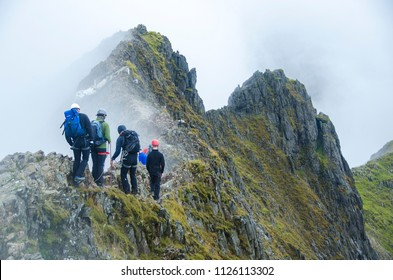 SNOWDONIA, WALES- SEPTEMBER, 2017: A group of climbers making their way across Crib Goch, a route to the Mount Snowdon summit famous for its steep drops