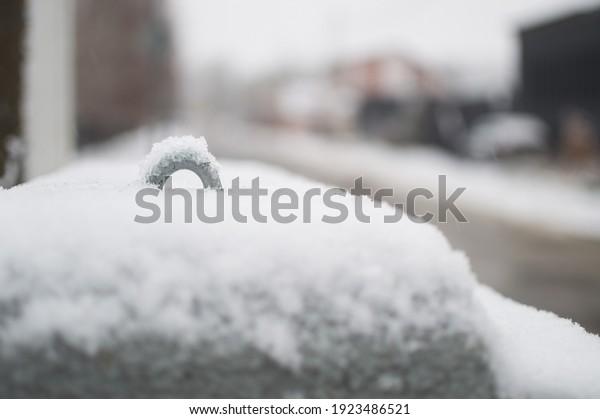 snowdrift-closeup-on-metal-surface-600w-