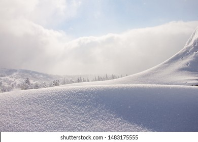 Snowdrift on the mountain in sunny weather. Beautiful natural lines. Snow skid