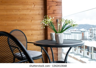 Snowdrops and drink mugs on balcony, Winter time