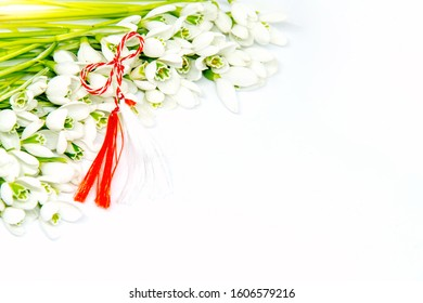 snowdrops and red and white string known as martisor romanian first of march tradition