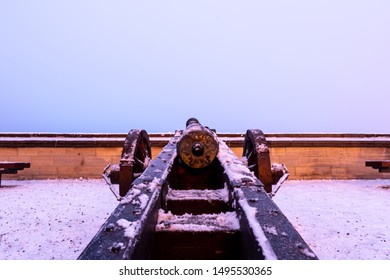Snowed in historical cannon on the castle terrace