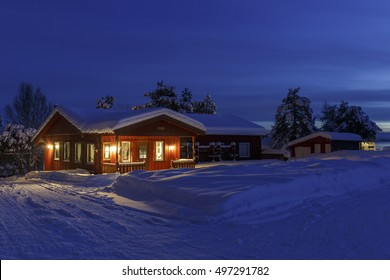 Snowed up wooden cabin on a campground in winter on Tranoyfjord on Senja Island, Troms county, Norway