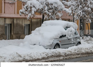 snowfall-car-covered-snow-260nw-12596056