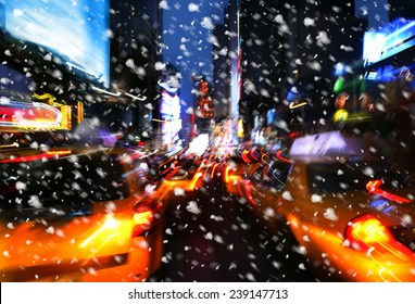 Snowfall. Illumination and night lights of New York City. Intentional motion blur