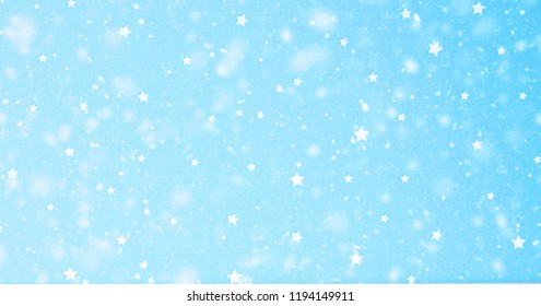 snowfall in light blue star sky