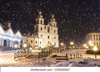 Snowfall in Minsk at winter night, Belarus. New Year and Christmas time in Minsk city. Cityscape of snowy Minsk. Cathedral of the Holy Spirit