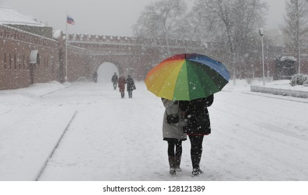 Snowfall in a park near Kremlin wall in Moscow