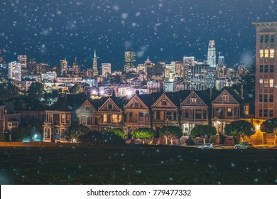 Snowfall in San Francisco; Painted Ladies and skyline at night