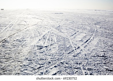 snowfield with tyre traces