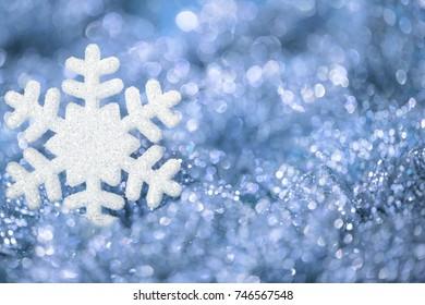 Snowflake Blue Background, Sparkling Snow Flakes Decoration over Defocused Lights Background