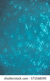 Snowflake Bokeh background. Winter, holiday texture and wallpaper.
