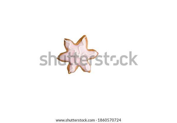 snowflake christmas honey gingerbread cookies homemade decorated with pink icing isolated on white background