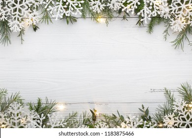 Snowflake and Christmas lights on wooden table