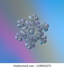 Snowflake glittering on blue gradient background. Macro photo of real snow crystal: elegant stellar dendrite with glossy relief surface, ornate shape, fine hexagonal symmetry and complex inner pattern