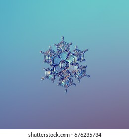 Snowflake glittering on blue gradient background. Macro photo of real snow crystal: star plate with fine symmetry, glossy relief surface, short arms with sharp edges and small hexagonal center.